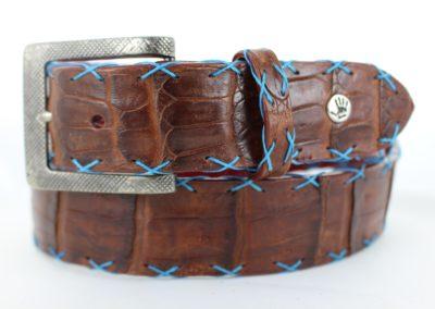 Cigar crocodile with teal cross stitch